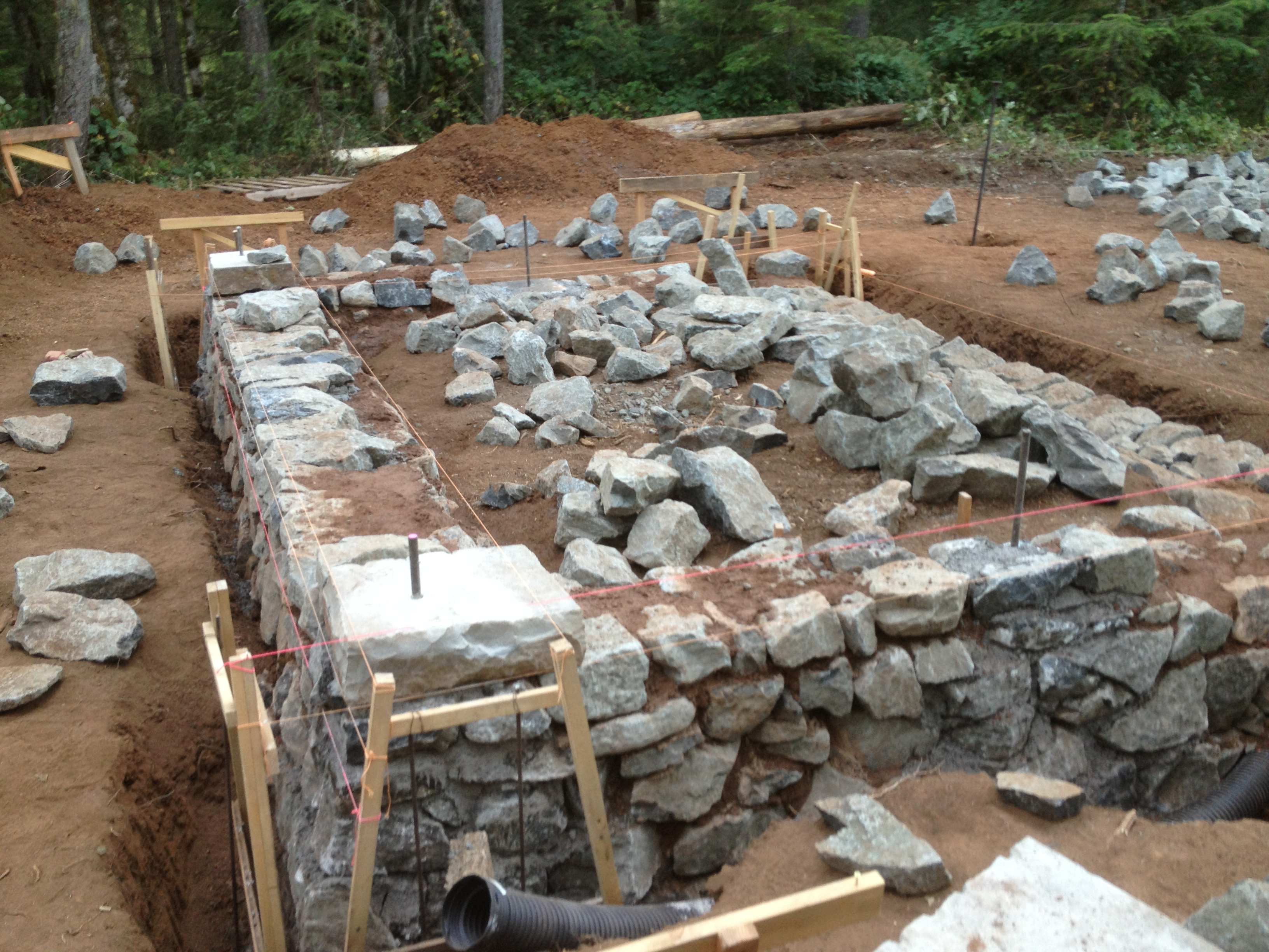Building a stone foundation this cob house for Home foundation